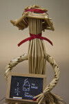 Saskatchewan, Canada - Doll Made from Wheat and Straw Holding a Chalkboard (Close Up)