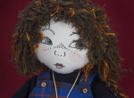 Scotland Fabric Doll with Printed Fabric Face, Yarn Hair, and Tartan Jumper (Three Quarter Close Up)