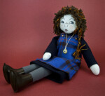 Scotland Handcrafted Young Girl Wearing Tartan Jumper Made in Poolewe in the United Kingdom (Three Quarter View)