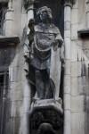 Sculpture of a Man Holding a Fruit