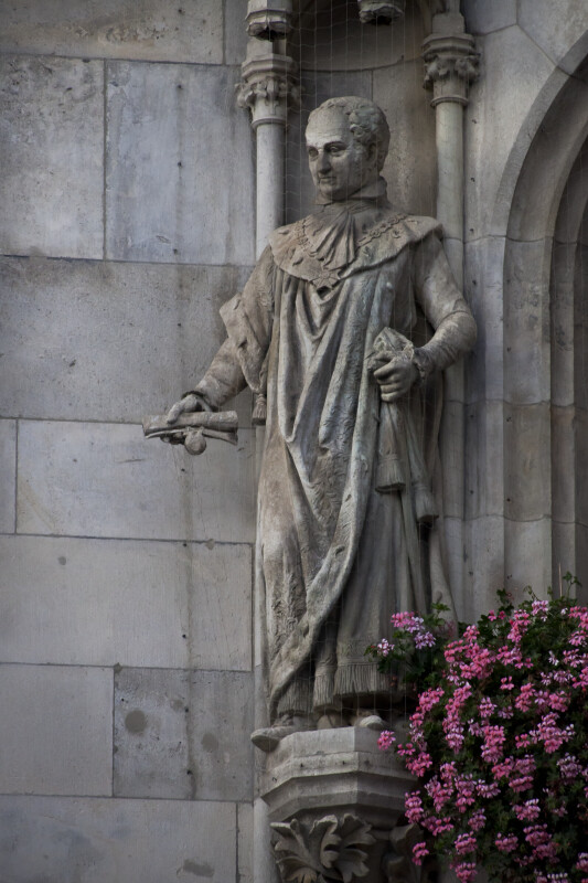 Sculpture of a Man Holding a Scroll