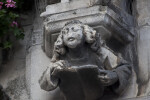 Sculpture of a Man Reading a Book on a Corbel