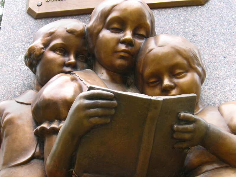 Sculpture of Children Reading a Book