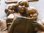 Sculpture of Children Reading a Book