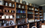 Shelves Filled with Stoneware, Glassware, and Kitchen Tools