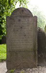 Shooting Damage on a Headstone