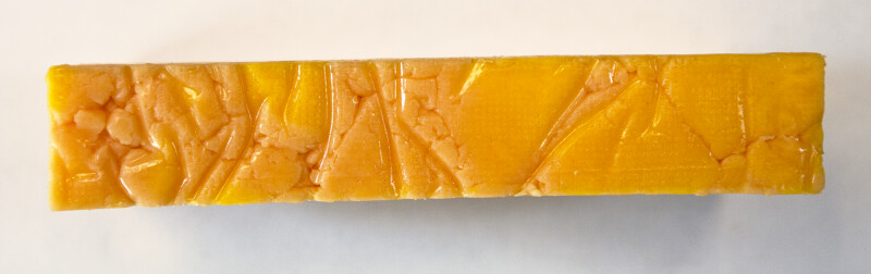 Side View of Cheddar Cheese Block