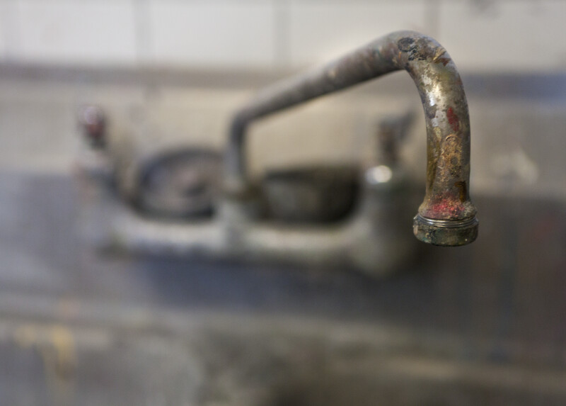 Sink Faucet in a Painting Studio