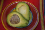 Sliced Avocado on a Colorful Plate