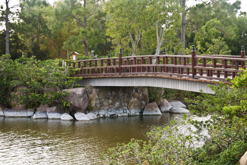 Small Bridge Extending over Pond