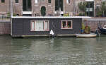 Small Houseboat on a Canal in Amsterdam