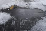 Snow Melting on Street