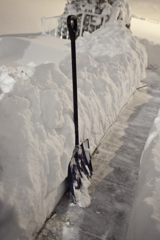 Snow Shovel on Sidewalk