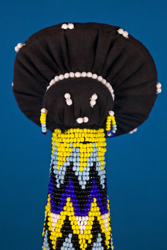 South Africa Zulu Matron Doll with Facial Features and Earrings Made from Beads (Close Up)