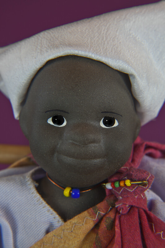 South African Figure Made with Stone-Fired Clay and Hand Painted Eyes (Extreme Close Up)