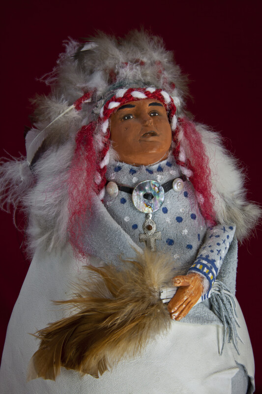 South Dakota Handcrafted Blackfoot Indian Chief with Elaborate Feather Headdress (Close Up)