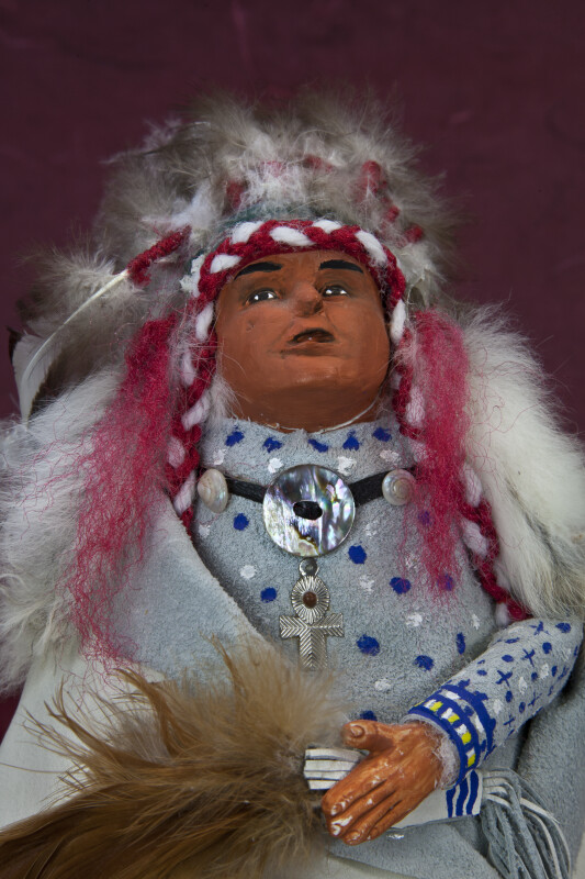 South Dakota Native American Chief with Hand Painted Face on Clay Wearing Feather Headdress (Close Up)