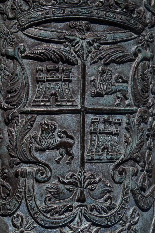 Spanish Symbols Carved Into a Bronze Piece