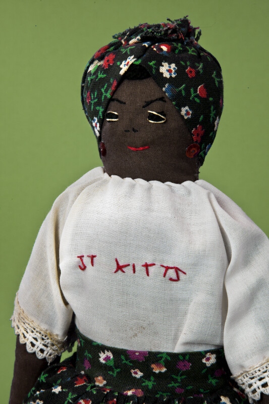 St. Kitts Hand Made Stuffed Lady Doll with Head Scarf and Sequin Earrings(Close Up)
