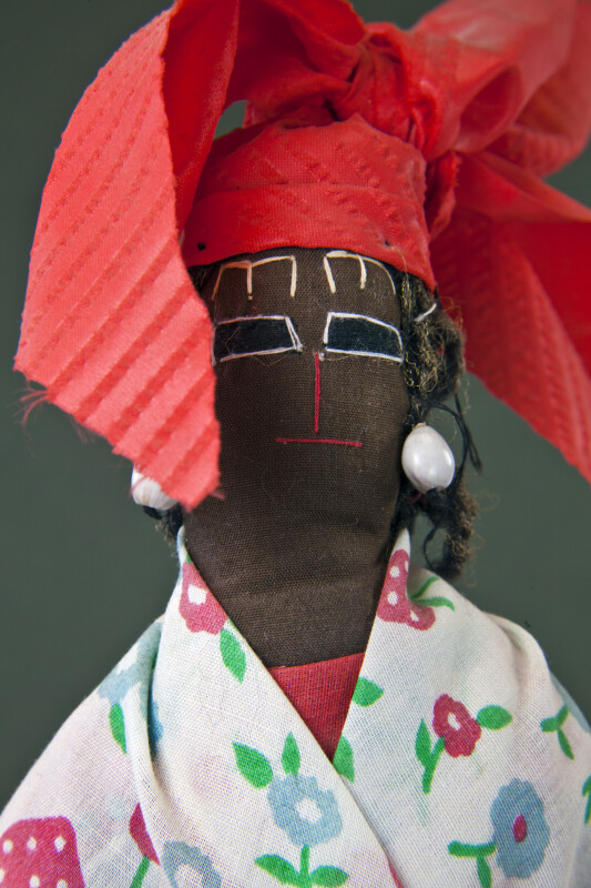 St. Lucia Stuffed Doll with Hand Stitched Face, Shell Earrings, and Wisp Broom for Body (Close Up)
