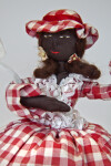St. Maarten Stuffed Doll with Embroidered Face and Lace Parasol (Close Up)