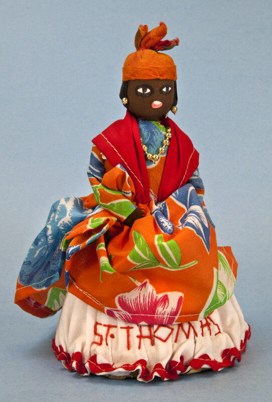 St. Thomas Handcrafted Woman Wearing Tropical Dress and African Head Wrap (Full View)