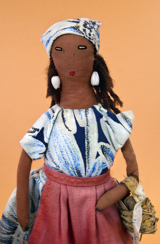 St. Vincent Island, Handmade Miniature of Woman from the Caribbean Holding a Basket (Close Up)