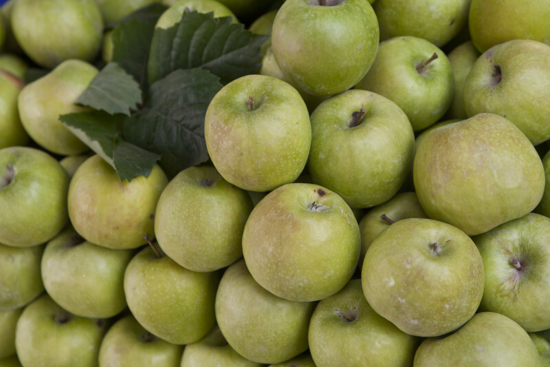 Stacked Green Apples Close-Up