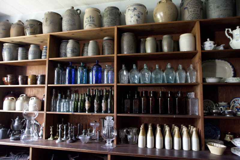 Stoneware and Glassware on Shelves