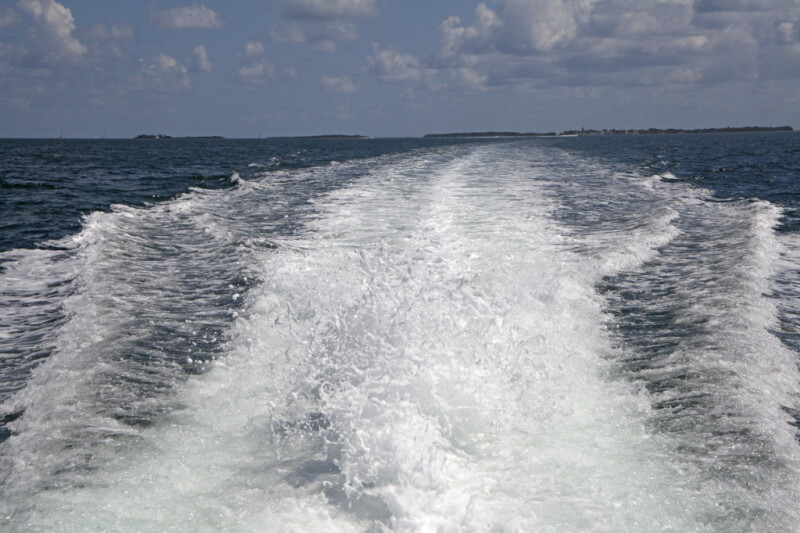 Stream of Water Formed Behind a Motorboat