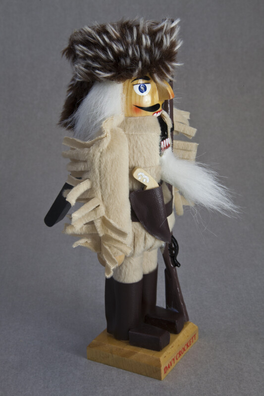 Tennessee Davy Crockett Figure with Wooden Rifle and Pistol (Three Quarter View)