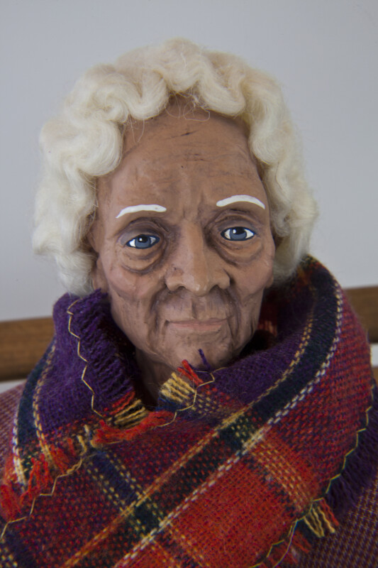 Texas Female Elderly Doll with White Wool Hair and Painted Ceramic Face (Close Up)