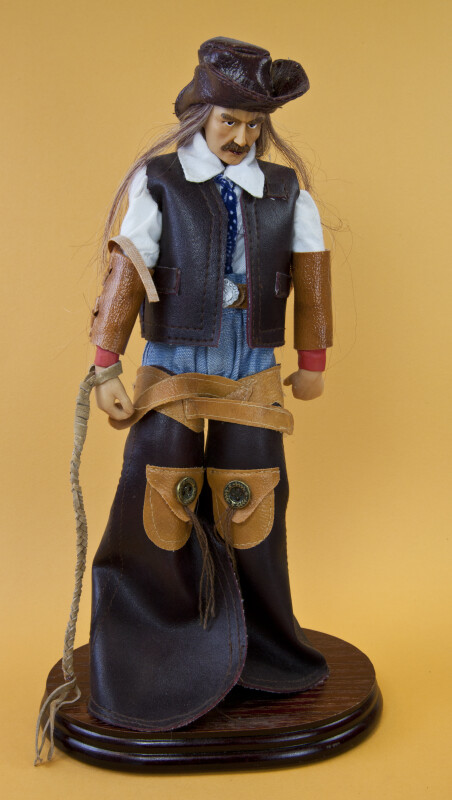 Texas Figurine of Cowboy Made with Ceramics and Wearing Cotton and Leather Clothing (Full View)