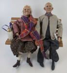 Texas Male and Female Senior Citizen Dolls by Karen Germany Sitting on a Bench (Full View)