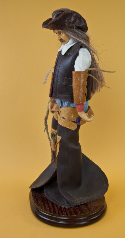 Texas Male Cowboy Figurine with Rope Lariat and Saddle (Profile View)
