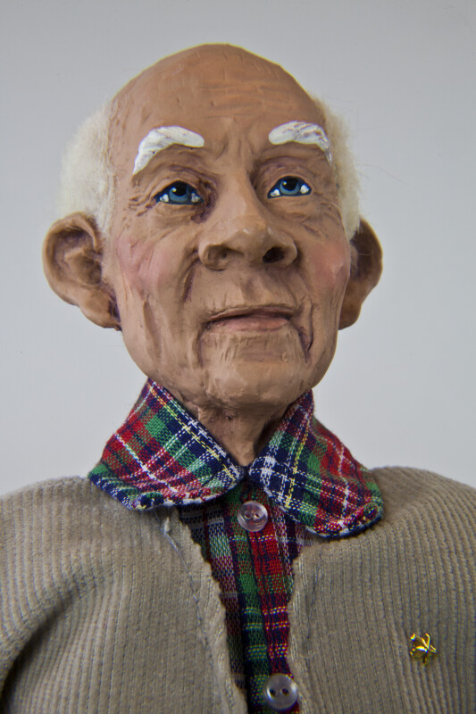Texas Senior Citizen Male with Ceramic Head Wool Hair and Eyebrows and Hand Painted Face (Close Up)
