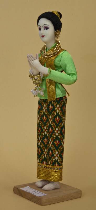 Thailand Female Doll Wearing Traditional Thai Clothes with Gold Sash and Trim (Three Quarter View)