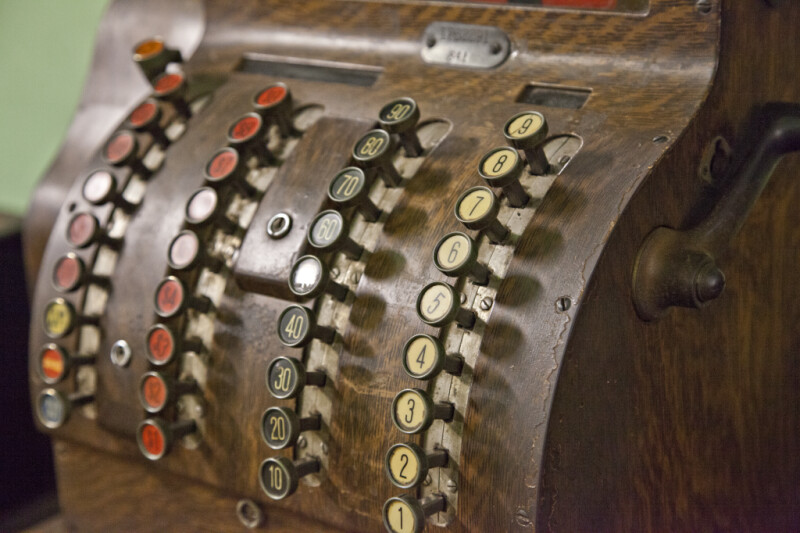 The Buttons on a Wooden Cash Register
