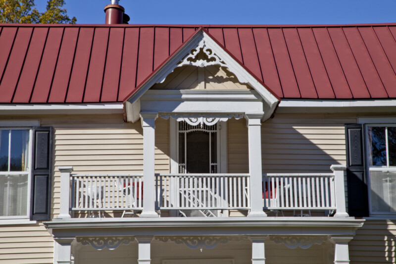 The Gingerbread Bargeboard on the Front Gabled Roof of a Full-Height Entry