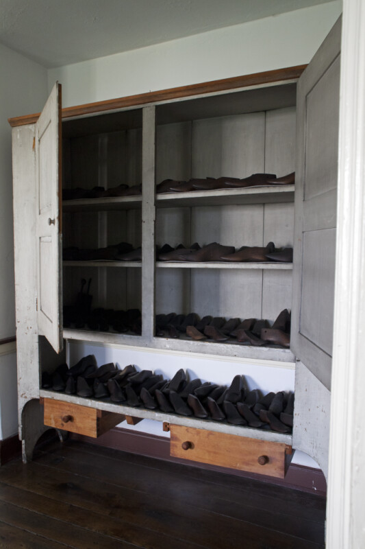 The Shoe Lasts in the Cabinet