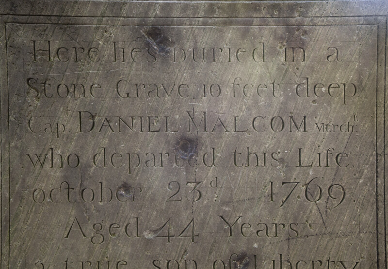 The Upper Half of Daniel Malcolm's Epitaph