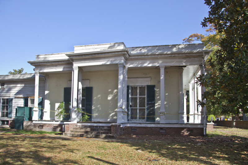There are Pediments with Medallions above the Windows of the Curlee House