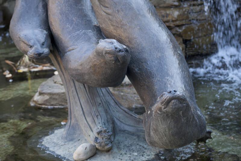 Three Otters Statue
