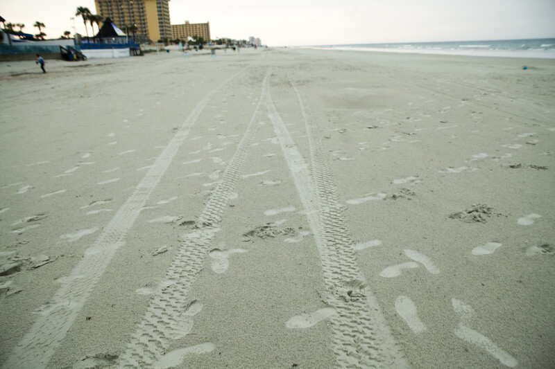 Tire tracks and Footprints on Beach