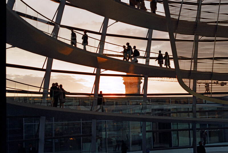 Tourists Enjoying the Sunset through the Dome of the Reichstag