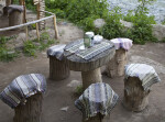 Tree Stump Chairs Around a Circular Wooden Table in the Ihlara Valley of Turkey