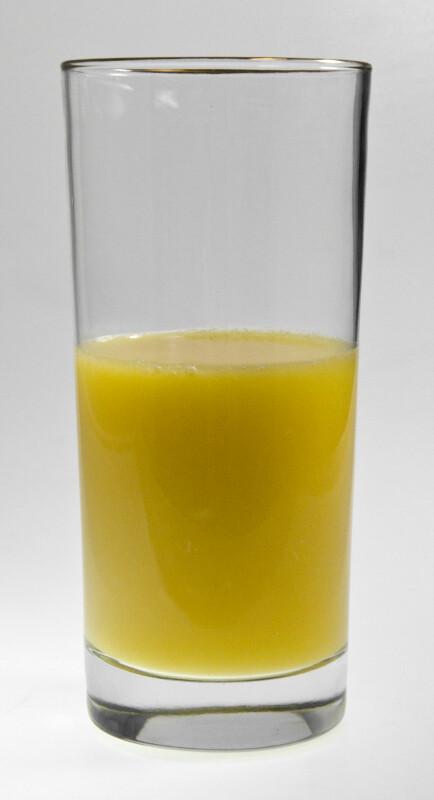 Tumbler of Orange Juice One-Half Full