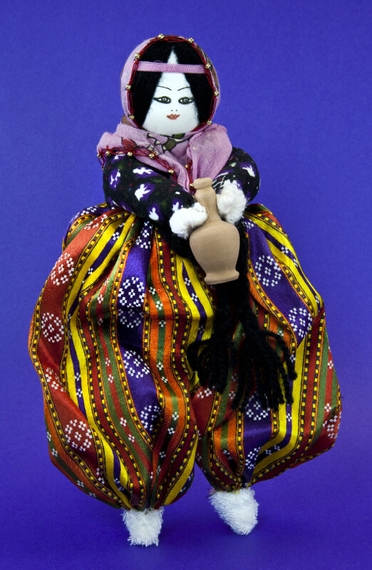 Turkey Female Doll Made from Stuffed Material and Wire Wearing a Loose Bright-Colored Dress (Full View)