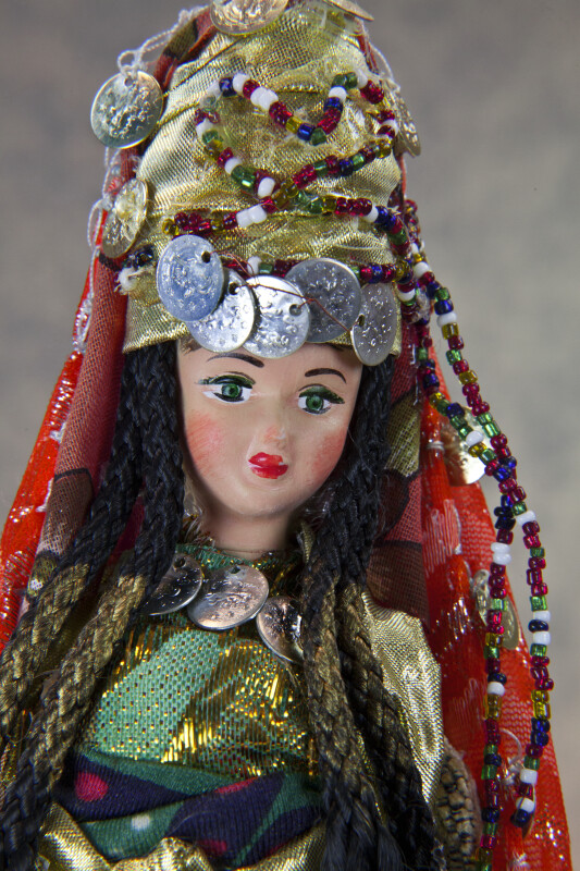 Turkey Handcrafted Female Figure with Ornate Headdress and Traditional Attire (Close Up)