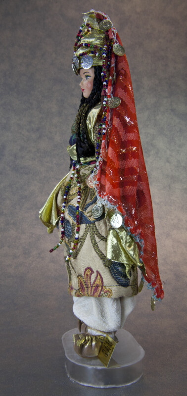 Turkey Woman in Traditional Dress Adorned with Coins and Beads (Profile View)
